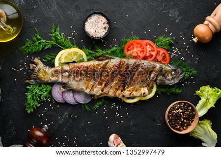 Baked Trout with Vegetables. Top view. Free space for your text. Rustic style. Stock photo ©
