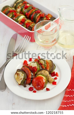 baked vegetables on the plate with fork and knife