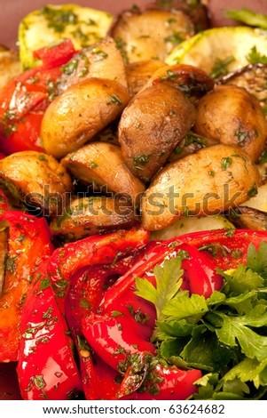 Baked vegetables: potato, pepper on plate. Vegetarian food