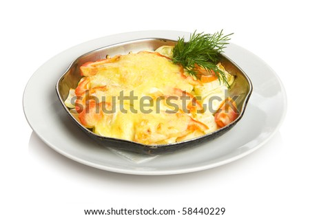 Baked vegetables - zucchini and tomatoes with cheese. Isolated on white by clipping path.