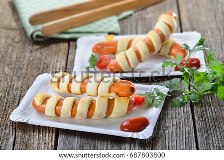 Baked Vienna sausages wrapped with puff pastry fresh from the oven, often served as a children's meal Stock photo ©