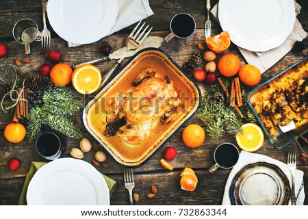 Baked Whole Chicken for Christmas or Thanksgiving Day Table with Fruits Seasonal Spices Metal Pallet Wooden Table Top View Main Course #732863344