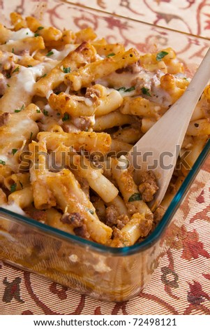 Baked ziti pasta with meat, tomato sauce, mozzarella, parmesan, and ricotta cheese.