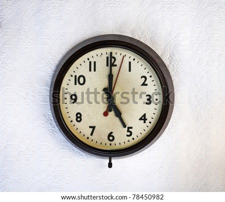Bakelite vintage clock on a white wall