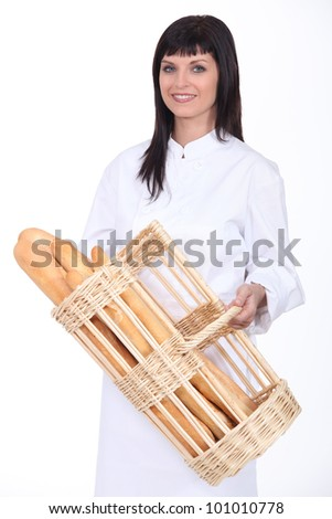 Baker with basket of bread