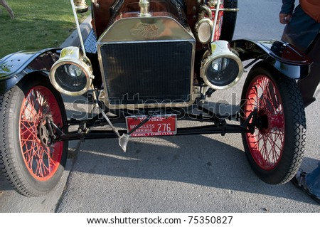 "BAKERSFIELD, CA - APR 14: The Bakersfield Horseless Carriage Club meets for an annual tour on April 14, 2011, at Bakersfield, California. This Ford ""Model T"" can still cruise the local roads. - stock photo"