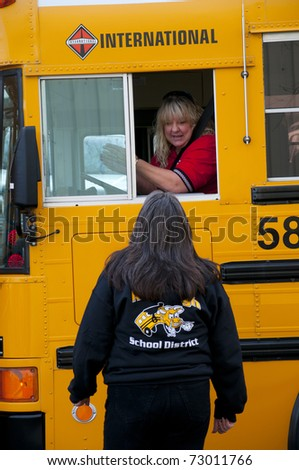 "BAKERSFIELD, CA - MAR 12: The 28th Annual School Bus ""Roadeo"" tests driver skills on March 12, 2011, in Bakersfield, California. Driver receives instructions from official."