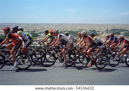 BAKERSFIELD, CA - MAY 20: A group of cyclists pushes up the last hill toward the finish of Stage 5, Amgen Tour of California on May 20, 2010, at Bakersfield, California.