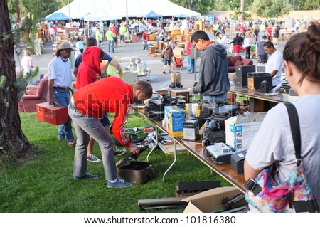 "BAKERSFIELD, CA - MAY 4: Many people turn out to eye merchandise and shop for bargains at the ""Junk-a-Tique"" huge yard sale held by the Calvary Bible Church on May 4, 2012,  in Bakersfield, California"