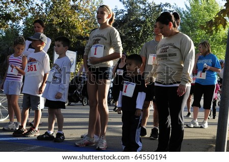 BAKERSFIELD, CA - NOV 6: Unidentified young runners start the fun run at the 28th Annual Police memorial Run on November 6, 2010, at Bakersfield, California.