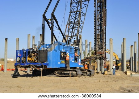BAKERSFIELD, CA - SEPT. 30: Construction of Mohawk St bridge over the Kern River is well underway setting precast concrete pilings on September 30, 2009 in Bakersfield, California. - stock photo