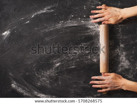 Bakery black background with roll and famale hands flat lay, top view, copy space, banner Stockfoto ©