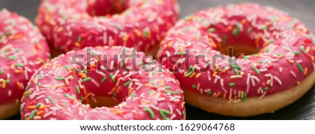 Bakery, branding and cafe concept - Frosted sprinkled donuts, sweet pastry dessert on rustic wooden background, doughnuts as tasty snack, top view food brand flat lay for blog, menu or cookbook design