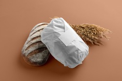 Bakery branding mockup, wrapped in paper bread, wheat, empty space to display your logo or design.