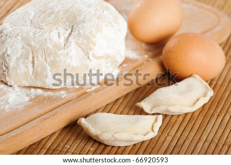 Bakery ingredient. Doug, raw eggs and dough nuts. Shallow depth of field - stock photo