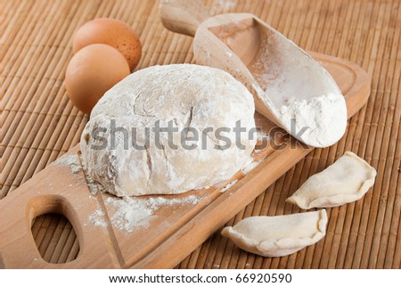 Bakery ingredient. Flour in spoon, fresh dough, raw eggs and dough nuts