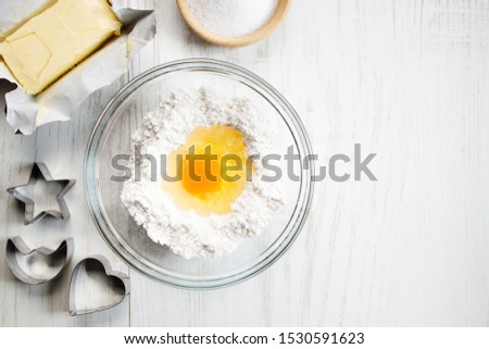 Bakery ingredients and tools on white wooden table. Baking or cooking background theme.