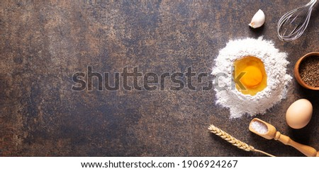 Bakery ingredients for homemade bread baking on table. Flour food and egg for recipe as panoramic top view at stone background texture with copy space, flat lay concept Foto stock ©