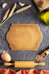 Bakery ingredients for homemade bread baking on table. Food recipe top view at stone background texture with copy space. Flat lay top view