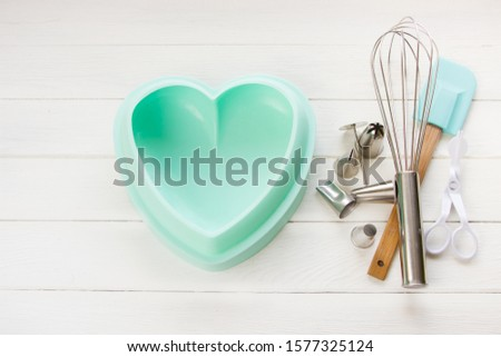 Baking and cooking concept. Baking tools for baking on a white  wooden background.Template design #1577325124