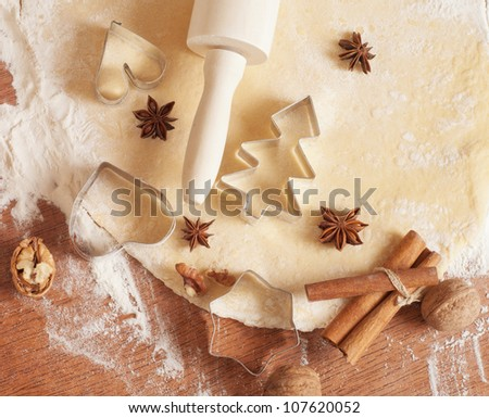 baking background with dough, spices and cookie cutters