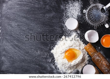 Baking background with eggshell,  flour and rolling pin .selective focus..Copy space.