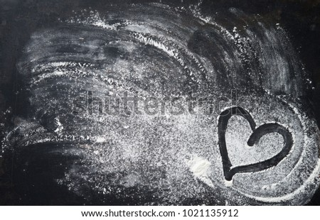 Baking background with heart shape and flour on the dark table. Copy space for text  #1021135912