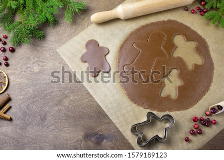 Baking christmas cookies on wooden table. Baking background #1579189123