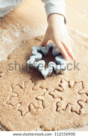 Baking Christmas snowflakes cookies