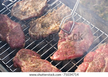 Baking chuck steaks on the barbecue
