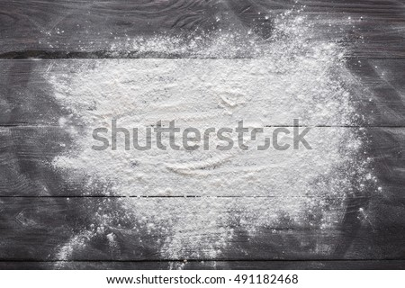 Baking class or recipe concept on dark background, sprinkled wheat flour with free text copy space. Baking preparation, top view on wooden board or table. Cooking dough or pastry. #491182468