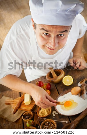 Baking concept background. Baker with ingredients for pastry desserts. Apples, lemon, sugar, walnuts