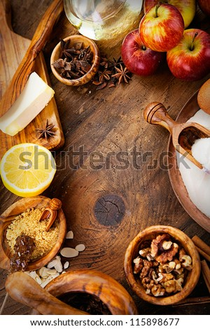 Baking concept background. Border design cooking,Christmas and winter  cookies ingredients.Baking pastry and cookies: apples, spices, sugar, eggs on wood