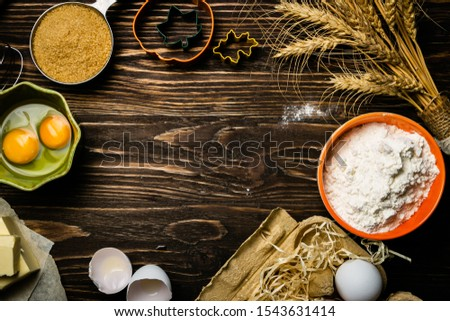 Baking concept - baking ingredients butter, flour, sugar, eggs on rustic wood background, top view #1543631414