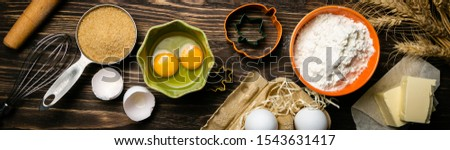 Baking concept - baking ingredients butter, flour, sugar, eggs on rustic wood background, top view #1543631417