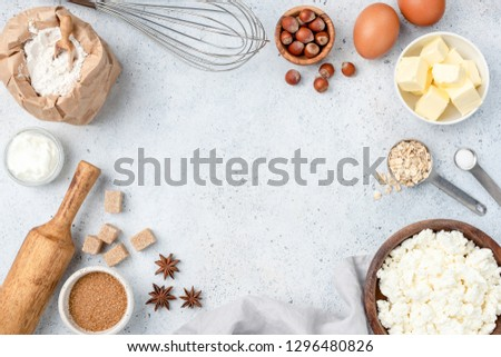 Baking concept, baking ingredients on background. Ingredients for baking cake, cookies, bread or pastry. Frame of cooking kitchen utensils and food #1296480826