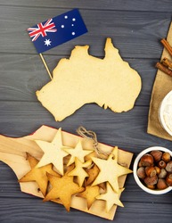 baking cookies in  shape of the continent of australia.  Happy Australia Day message greeting card