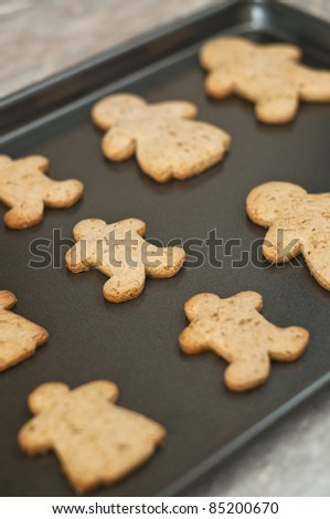 Baking gingerbread man in a tray