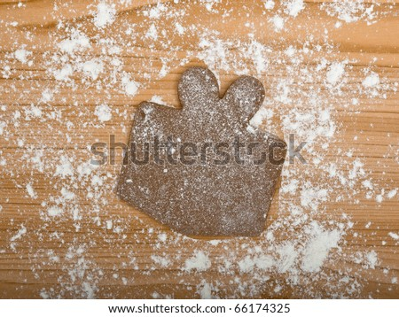 Baking homemade Gingerbread christmas cookies with a shape of a gift