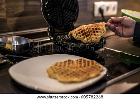 Baking Homemade waffles cooked in a waffle iron #605782268