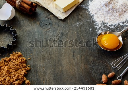 Baking  ingredients - flour, sugar, egg, butter on vintage wood table. Top view. Rustic background with free text space.