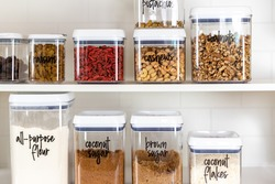 Baking ingredients in BPA-free plastic storage containers with labels