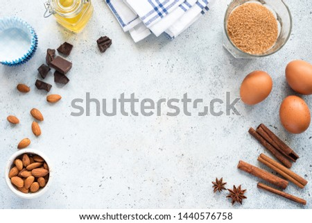 Baking Ingredients Oil Eggs Sugar Nuts Chocolate And Spices Cinnamon Anise Star On Background, Frame Composition