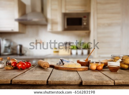 Baking ingredients placed on wooden table, ready for cooking. Copyspace for text. Concept of food preparation, kitchen on background. #616283198