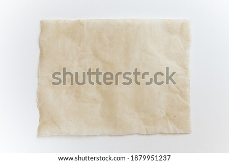 Baking paper sheet isolated on white background, top view. Parchment for baking culinary.