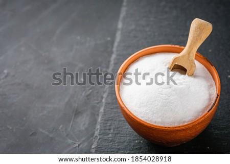 baking soda powder on a dark stone background Photo stock ©