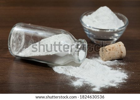 Baking soda - sodium bicarbonate in a glass jar on dark wooden background. Photo stock ©