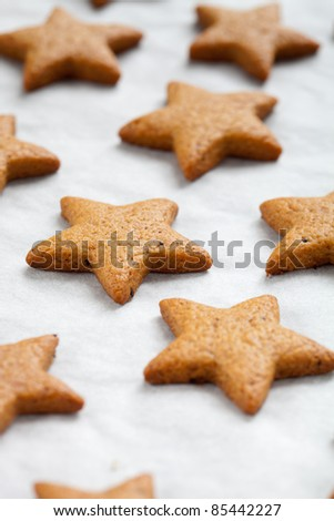 Baking star shape christmas cookies, selective focus