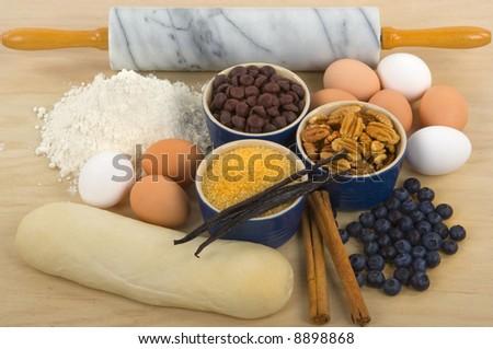 Baking time (flour, raw sugar, chocolate, blueberries, cinnamon sticks, vanilla beans, pecans and eggs)