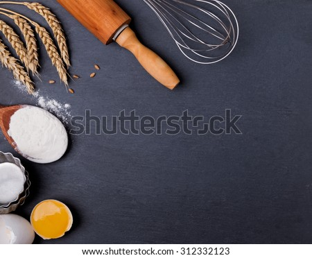 Baking tools on the black board, top view